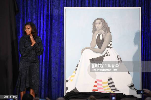 Former First Lady Michelle Obama stands next to her portrait as she and former President Barack Obama have their portraits unveiled at the...