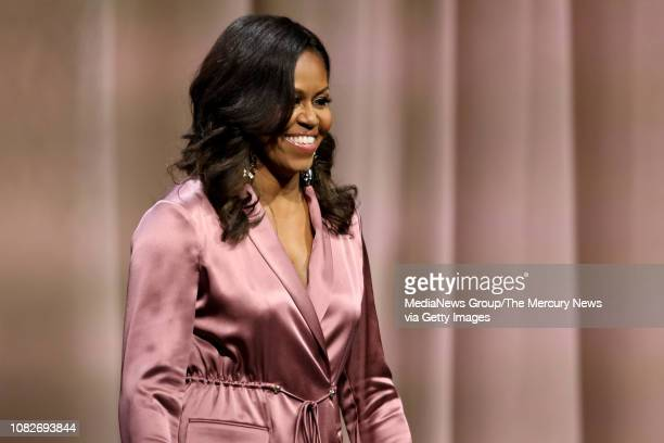 """Former First Lady Michelle Obama takes the stage at the SAP Center during her """"Becoming"""" book tour stop in San Jose, Calif., on Friday, Dec. 14,..."""