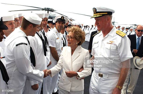 Former First Lady Nancy Reagan and Commander US Naval Air Force Pacific Vice Adm Michael D Malone greet sailors on the flight deck after her arrival...