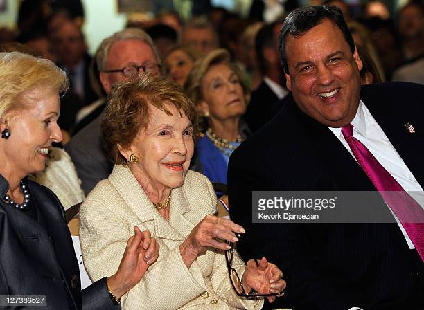 Former first lady Nancy Reagan is joined by New Jersey Governor Chris Christie and Gayle Wilson wife of former California Gov Pete Wilson before...