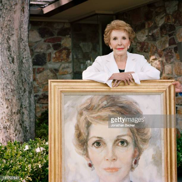 Former first lady Nancy Reagan is photographed at home with her painted Marion Hewlett Pike portrait for Vanity Fair Magazine on July 1 2009 in Bel...