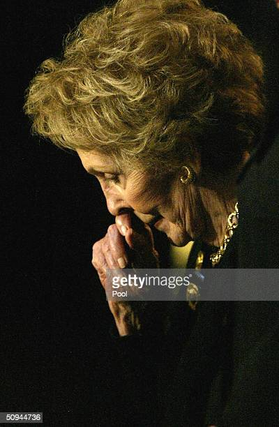 Former first lady Nancy Reagan pauses during the state funeral for former U.S. President Ronald Reagan on Capitol Hill June 9, 2004 in Washington,...
