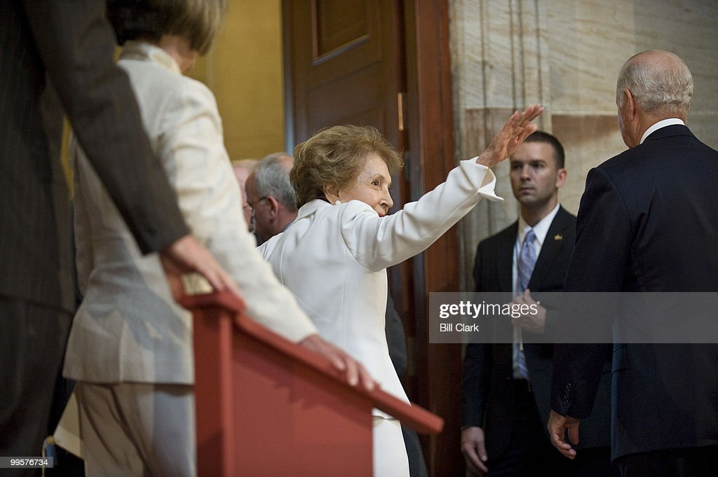 Former First Lady Nancy Reagan waves to the crowd as she leaves the Rotunda following the ceremony to unveil a statue of former President Ronald Reagan that will become part of the National Statuary Hall Collection on in the U.S. Capitol on Wednesday, June 3, 2009.