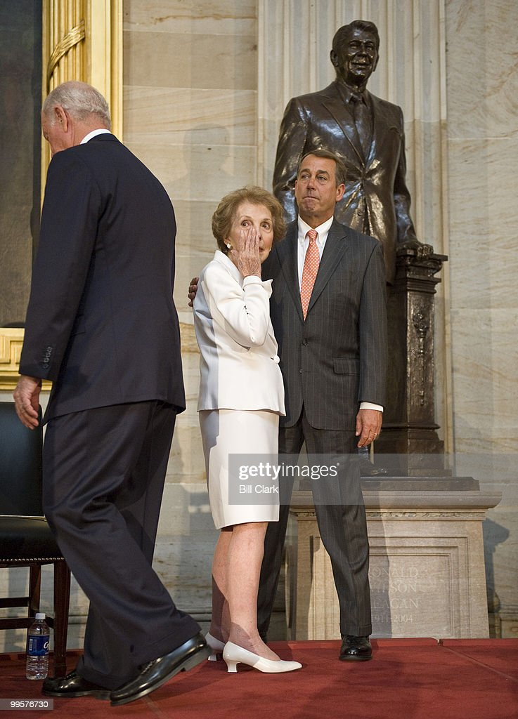 Former First Lady Nancy Reagan wipes away a tear as House Minority Leader John Boehner, R-Ohio, comforts her during the ceremony to unveil a statue of former President Ronald Reagan that will become part of the National Statuary Hall Collection on in the U.S. Capitol on Wednesday, June 3, 2009. James Baker is pictured to the left.