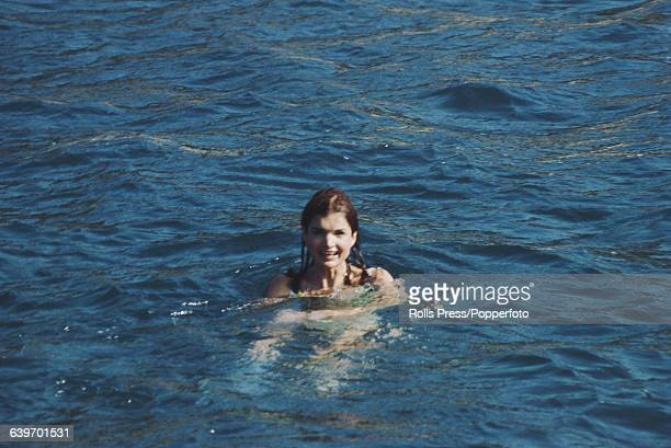 Former First Lady of the United States, Jacqueline Kennedy Onassis pictured swimming in the sea off the Greek island of Skorpios, owned by her...