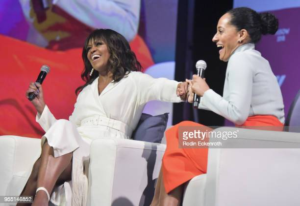 Former First Lady of The United States Michelle Obama and actress Tracee Ellis Ross have a conversation on stage at The United State of Women Summit...