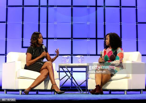 Former First Lady of the United States Michelle Obama and Screenwriter director and producer Shonda Rhimes speak on stage during Pennsylvania...