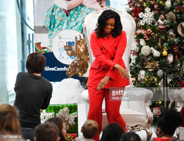 Former First Lady of the United States Michelle Obama dances with Children's Hospital Colorado patient Emma Jones ahead of her book signing event...