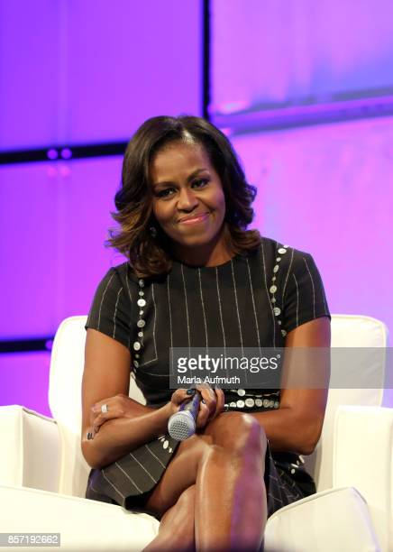Former First Lady of the United States Michelle Obama watches the surprise video message from her husband Former President of the United States...