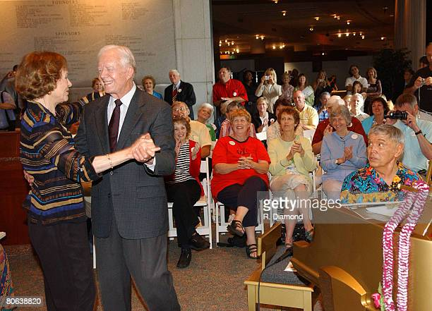 Former First Lady Rosalynn Carter and former President Jimmy Carter with pianist Roger Williams