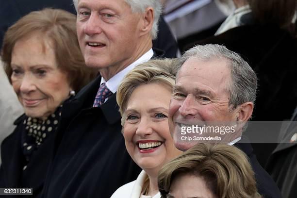 Former first lady Rosalynn Carter, Former U.S. President Bill Clinton, former first lady Hillary Clinton, and former President George W. Bush attend...
