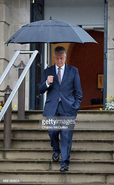 Former first Minister of Northern Ireland and DUP leader Peter Robinson makes his way down the steps of Stormont castle as he holds a press...