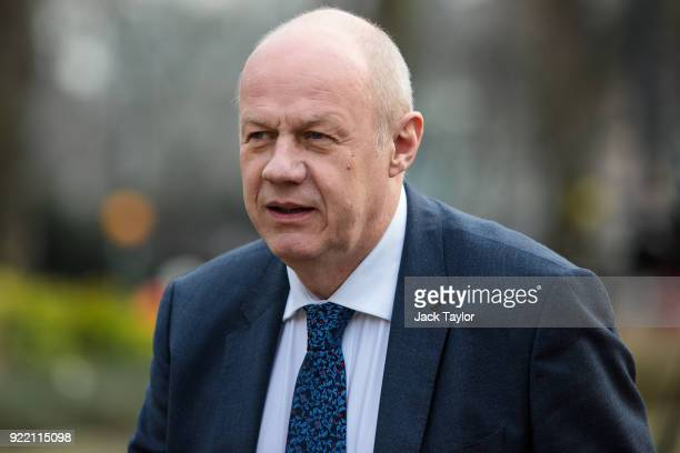 Former First Secretary of State and Minister for the Cabinet Office Damian Green walks along College Green in Westminster on February 21 2018 in...