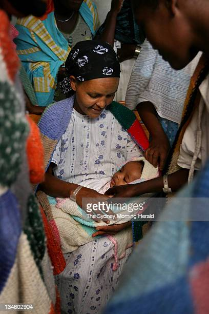 A former fistula patient who has returned to give birth holds her baby surrounded by fistula patients at the Addis Ababa Fistula Hospital in Ethiopia...