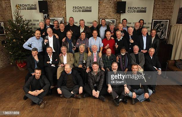 Former fleet street photographers reunite for a Christmas lunch at the Frontline Club on December 17, 2011 in London, England. The reunion, which...