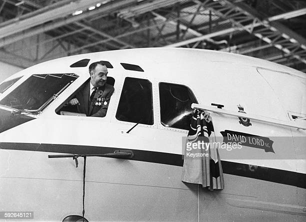 Former Flight Lieutenant William Reid VC leaning out of the cockpit window of one of the first RAF VC10 transport aircraft to be names after Victoria...