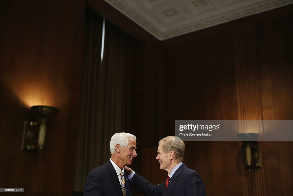 Former Florida Gov. Charlie Crist and U.S. Sen. Bill Nelson (D-FL) talk before a committee hearing on voting rights at the Dirksen Senate Office Building on Capitol Hill December 19, 2012 in Washington, DC. According to the committee, the hearing focused on Americans' access to the voting booth 'and the continuing need for protections against efforts to limit or suppress voting.'
