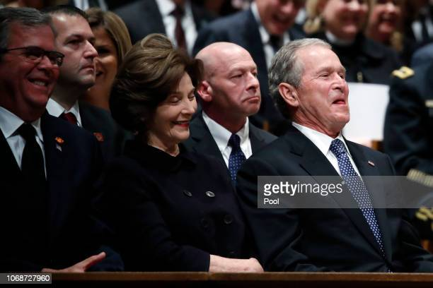 Former Florida Gov. Jeb Bush, former first lady Laura Bush and former President George W. Bush smile during a state funeral for former President...