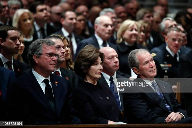 Former Florida Gov. Jeb Bush, Laura Bush and former President George W. Bush listen during a state funeral for former President George H.W. Bush at...