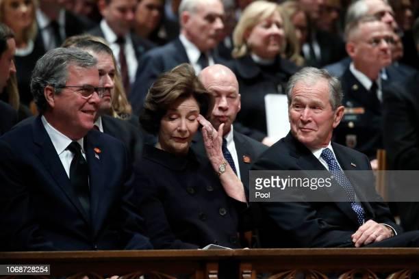 Former Florida Gov Jeb Bush Laura Bush and former President George W Bush listen during a state funeral for former President George HW Bush at the...