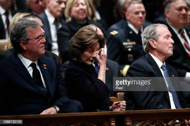 Former Florida Gov. Jeb Bush, Laura Bush and former President George W. Bush listen during the state funeral for former U.S. President George H. W....