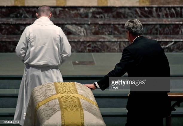Former Florida Gov Jeb Bush places his hand on the casket of his mother former first lady Barbara Bush during a funeral service at St Martin's...