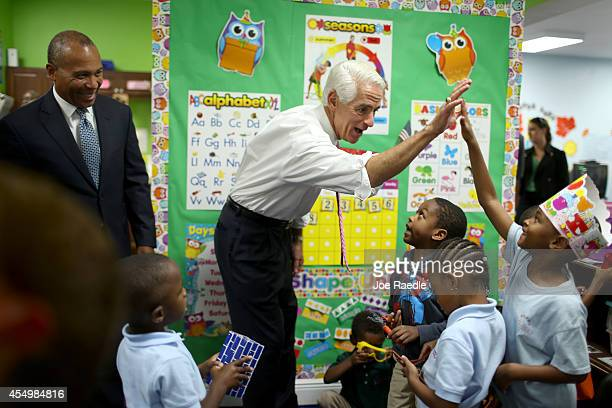 Former Florida Governor and current Democratic Party candidate for Governor, Charlie Crist and Massachusetts Governor Deval Patrick greet children...