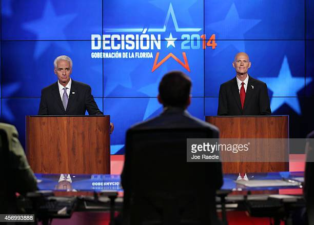 Former Florida Governor and Democratic candidate for Governor Charlie Crist and Republican Florida Governor Rick Scott are seen during their debate...