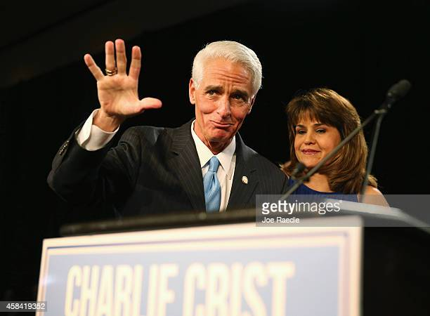 Former Florida Governor and Democratic gubernatorial candidate Charlie Crist waves as he stands with Annette Taddeo his Democratic lieutenant...