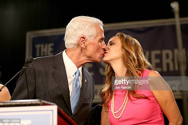 Former Florida Governor and Democratic gubernatorial candidate Charlie Crist kisses his wife Carole Crist as he concedes defeat in the Vinoy hotel on...