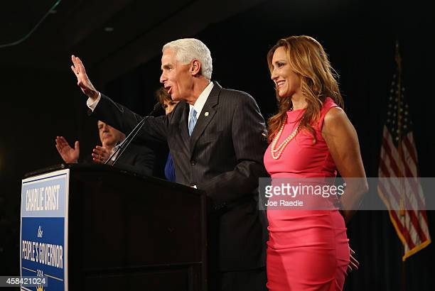 Former Florida Governor and Democratic gubernatorial candidate Charlie Crist waves goodbye as he stands with his wife Carole Crist as he concedes...