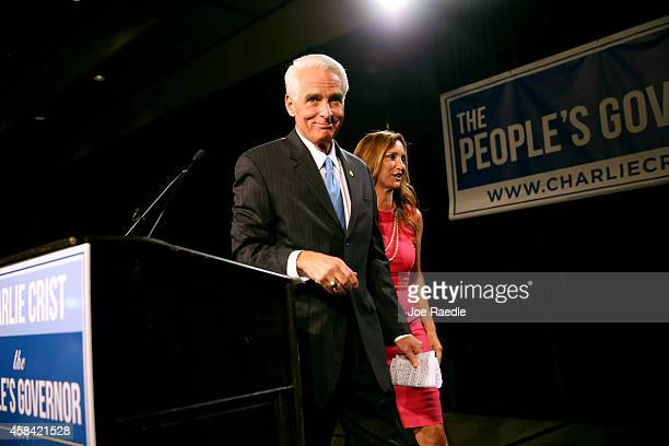 Former Florida Governor and Democratic gubernatorial candidate Charlie Crist walks off stage with his wife Carole Crist as he concedes defeat in the...