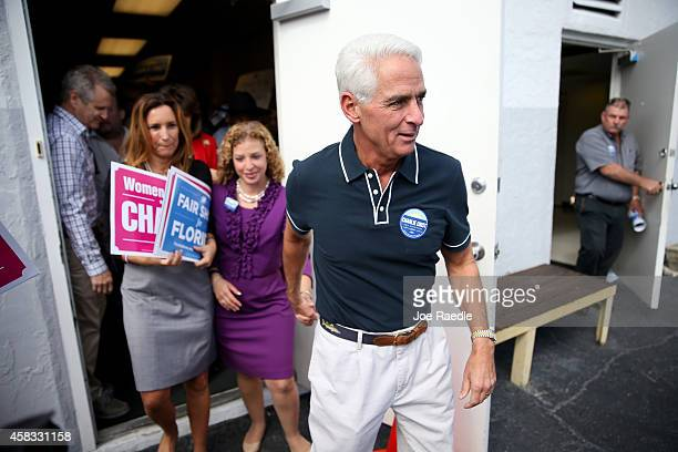 Former Florida Governor and now Democratic gubernatorial candidate Charlie Crist walks with Rep Debbie Wasserman Schultz the Democratic National...