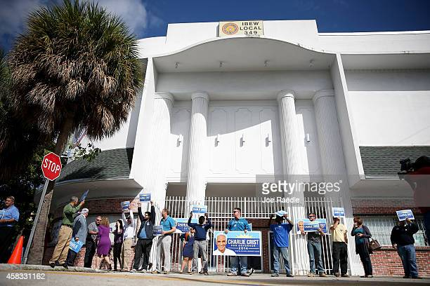 Former Florida Governor and now Democratic gubernatorial candidate Charlie Crist supporters await the arrival of their candidate on November 3 2014...