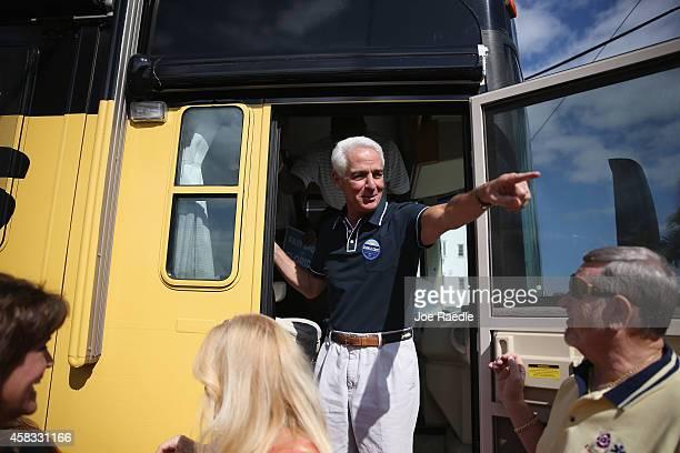 Former Florida Governor and now Democratic gubernatorial candidate Charlie Crist exits from his bus as he greets people during a campaign stop at the...