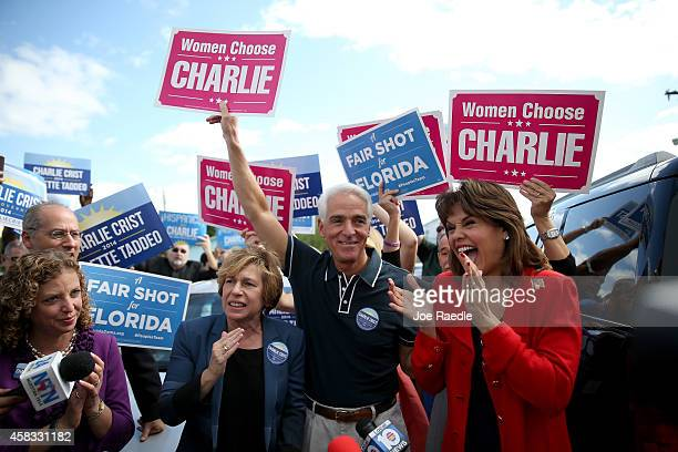 Former Florida Governor and now Democratic gubernatorial candidate Charlie Crist stands with Debbie Wasserman Schultz the Democratic National...