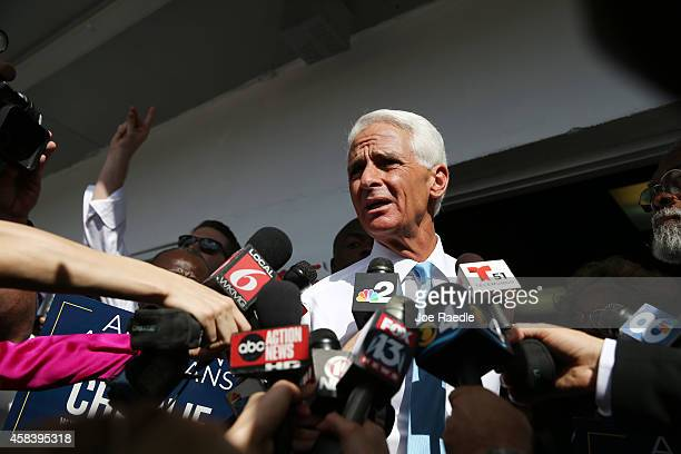 Former Florida Governor and now Democratic gubernatorial candidate Charlie Crist speaks to the media as he makes an election day phone bank visit to...