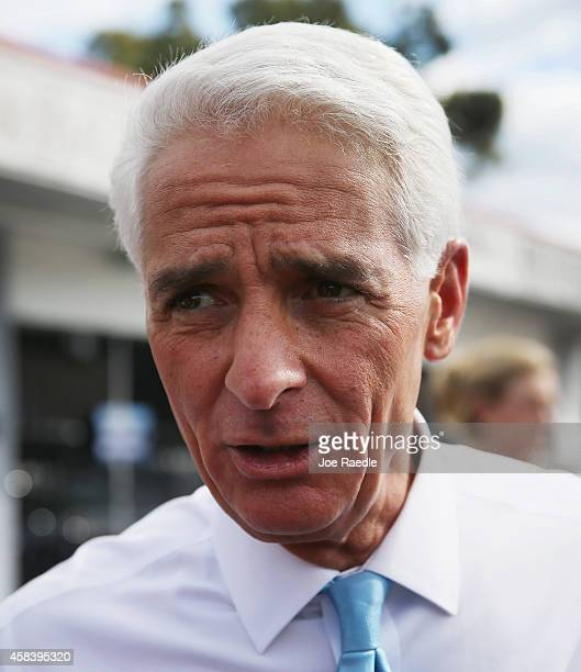 Former Florida Governor and now Democratic gubernatorial candidate Charlie Crist talks with supporters as he makes an election day phone bank visit...