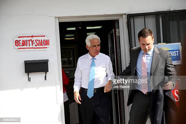Former Florida Governor and now Democratic gubernatorial candidate Charlie Crist walks out of th Total Image Hair Salon after making an election day...