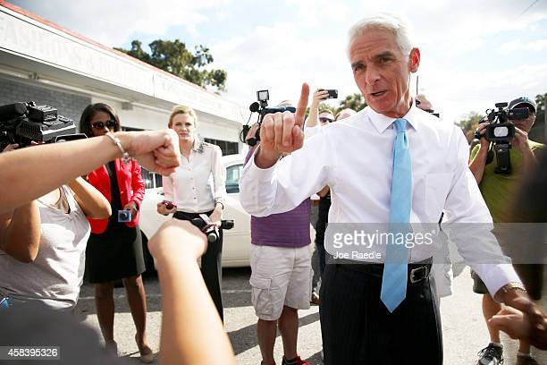 Former Florida Governor and now Democratic gubernatorial candidate Charlie Crist greets supporters as he makes an election day phone bank visit to...