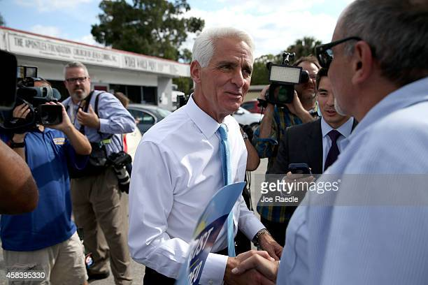 Former Florida Governor and now Democratic gubernatorial candidate Charlie Crist greets a supporter as he makes an election day phone bank visit to...