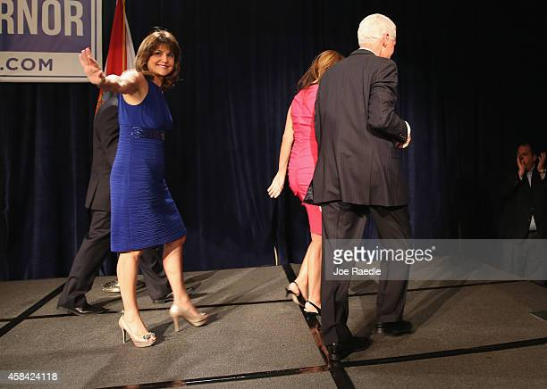 Former Florida Governor and now Democratic gubernatorial candidate Charlie Crist walks off stage with his wife Carole Crist followed by Annette...