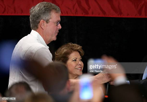 Former Florida Governor and potential Republican presidential candidate Jeb Bush arrives with his wife Columba Bush during a fundraising event at the...