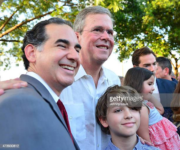 Former Florida Governor and potential Republican presidential candidate Jeb Bush greets people ans pose for picture as he attends a fundraising event...