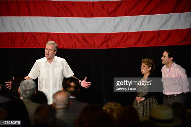 Former Florida Governor and potential Republican presidential candidate Jeb Bush speaks to supporters as his wife Columba Bush and son Jeb Bush jr...