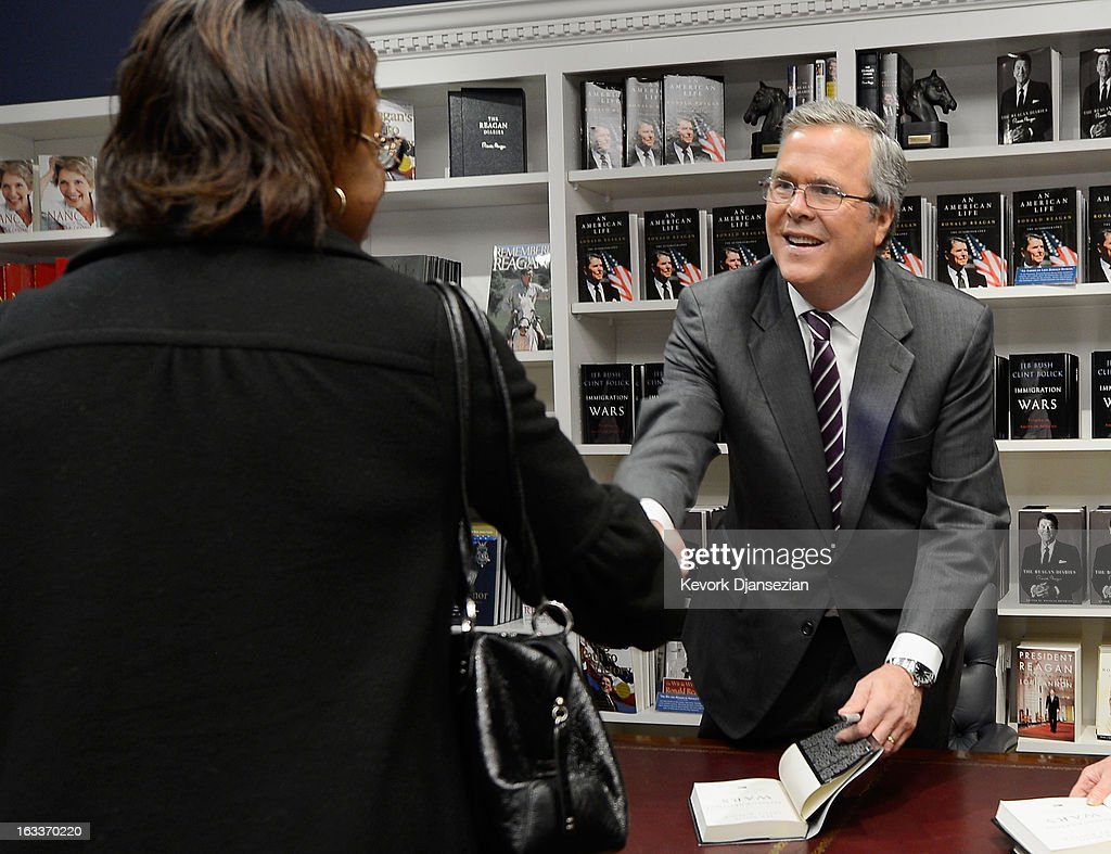Former Florida governor Jeb Bush autographs his new book 'Immigration Wars: Forging an American Solution' before speaking at the Reagan Library about his new book on March 8, 2013 in Simi Valley, California. Bush discussed the leadership and policy changes he believes are required to turn the country around.