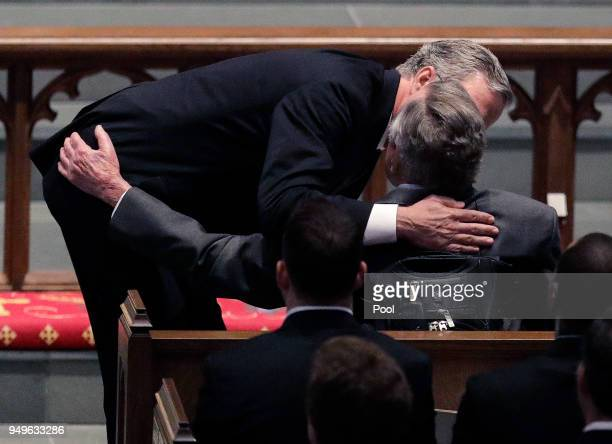 Former Florida Governor Jeb Bush comforts his father former President George HW Bush during a funeral service for his mother former first lady...