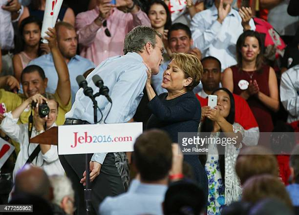 Former Florida Governor Jeb Bush greets his wife Columba Bush after announcing his plan to seek the Republican presidential nomination during an...