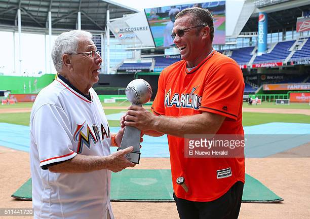 Former Florida Marlins manager Jack McKeon, left, gives the championship trophy to the winner of the Marlins Alumni Home Run Derby Invitational,...