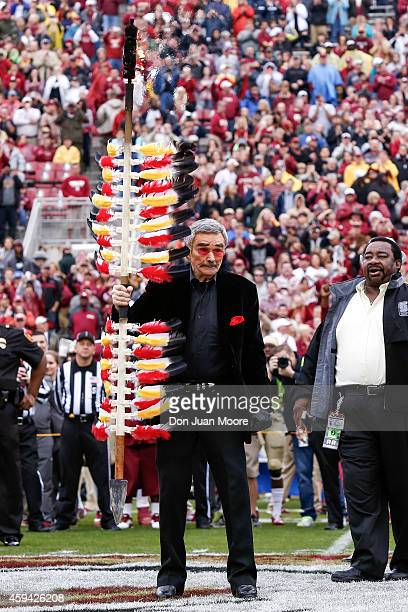 Former Florida State football player actor Burt Reynolds plants the spear midfield before the game against the Boston College Eagles at Doak Campbell...